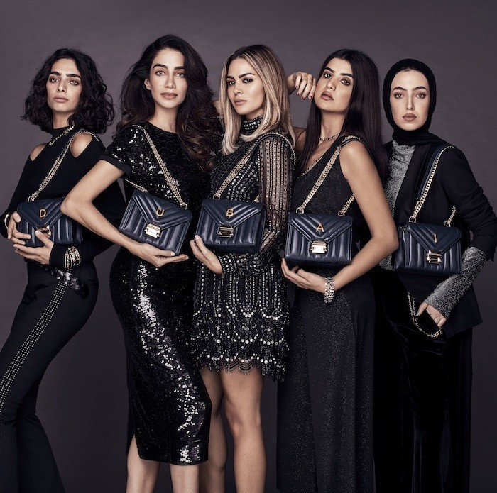 Michael Kors introducing the Whitney Handbag Across the Middle East